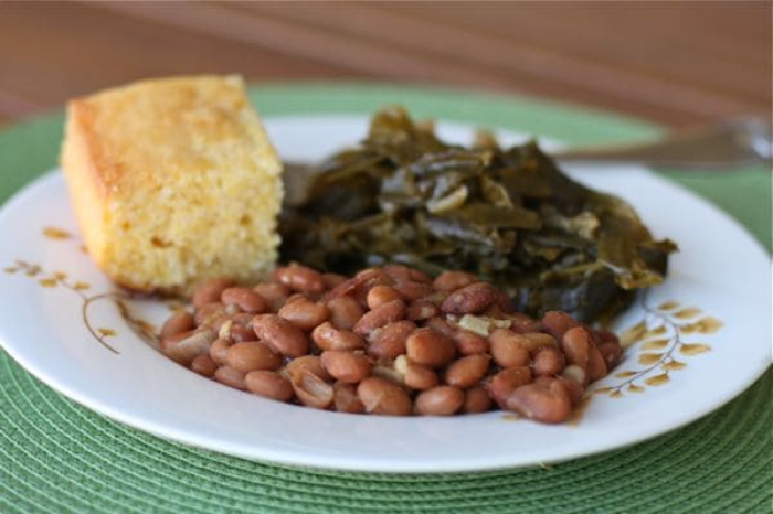 cornbread, greens and beans on plate