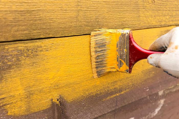 repainting a garden fence