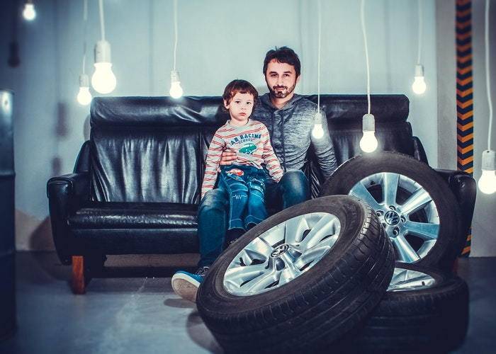 man and child with new tires
