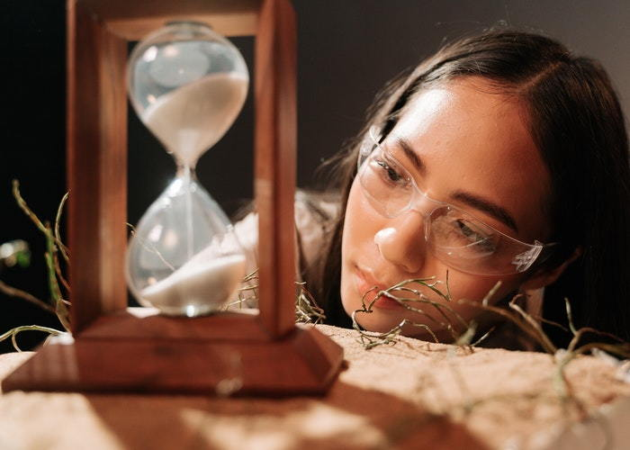 young person with hour glass