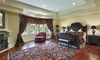 large bedroom with oriental area rug as a central point