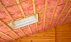 a framed ceiling filled with pink insulation
