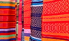 bright colorful berber carpets hanging together