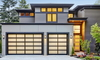 tall home with Japanese style garage doors