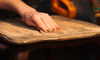 Woman sanding an antique table