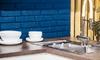 kitchen sink, coffee cups, and blue painted brick backsplash