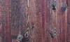 A distressed hardwood floor.
