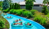 people on floats in a backyard lazy river