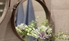 faux leather hanging frame around circular mirror with flowers