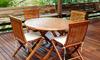 Teak dining set on a deck