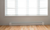 Baseboard heater along a white wall
