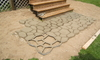 A decorative geometric pattern in a concrete pathway.
