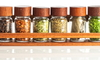 A magnetic spice rack in a kitchen.