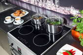 A cooktop with pots on it.