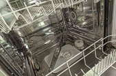 The inside of an empty dishwasher.