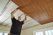 Man installing plank ceiling