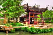 beautiful pagoda in park with large pond