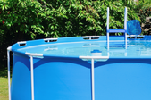 a blue, above ground pool