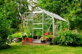 A greenhouse full of flowers and plants.