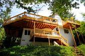 A mega cedar deck in need of winterizing.