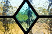 leaded glass window with diamond shape in center