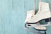 Ice skates hanging on a wall