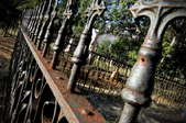 Old, weathered, ornate metal fencing