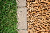 paver stones between grass and gravel