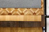Different rolls of linoleum flooring