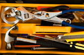 A tool box with tools for a variety of repairs.