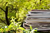 Stack of newspapers in the garden.