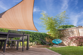 A sunshade in a backyard.