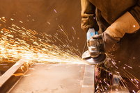 using an angle grinder with flying sparks