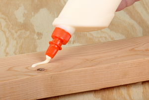 glue being piped out on wood