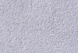 A close-up view of a textured ceiling.