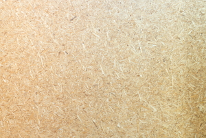 A close-up of a particle board texture.