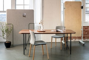 Table with a door and room dividers in the background