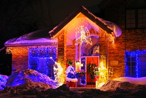 A brick house at night with Christmas lights.