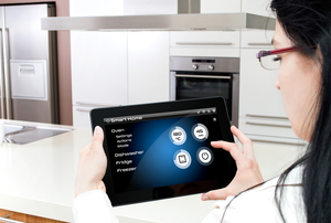 Someone operating a smart kitchen from a tablet.