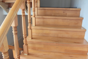 A set of completed wooden stairs with no finish.