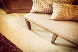 Creamy tan upholstered bench and matching carpet