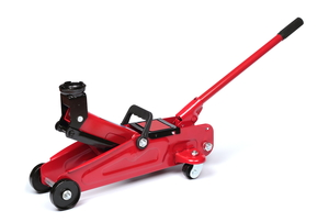 A red, hydraulic floor jack isolated on a white background.