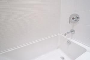 Bathtub with white walls