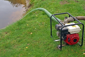 pumping vacuum cleaning a pond