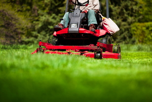 person using a riding lawn mower