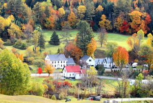 a new england town with fall foliage