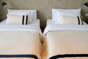 two twin beds next to each other