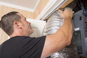 Man installing flexible ductwork