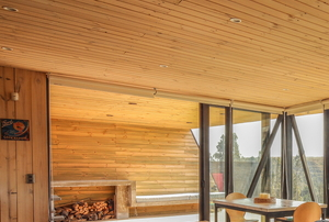 a room with wood walls and ceiling