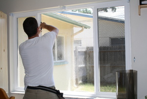 Man installing window film